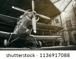 Small photo of historical airplane in an hangar