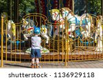 the child looks at old french...   Shutterstock . vector #1136929118