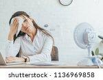 sweaty businesswoman working in ... | Shutterstock . vector #1136969858