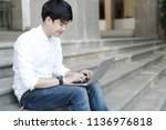 smiling college student sitting ... | Shutterstock . vector #1136976818