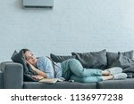 woman sleeping on sofa with... | Shutterstock . vector #1136977238