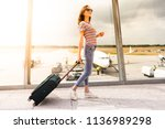 a young woman is waiting her... | Shutterstock . vector #1136989298
