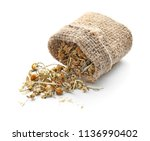 sack with dried chamomile... | Shutterstock . vector #1136990402