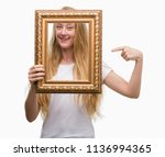 blonde teenager woman holding... | Shutterstock . vector #1136994365
