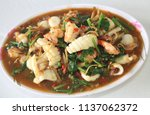 fried stir spicy seafood with... | Shutterstock . vector #1137062372