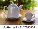 tea cup with tea pot on wooden... | Shutterstock . vector #1137105308