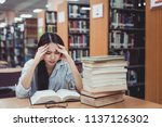 old book on the desk in library ... | Shutterstock . vector #1137126302