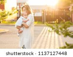 hild feels all the warmth and... | Shutterstock . vector #1137127448