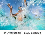 happy boy playing and splashing ... | Shutterstock . vector #1137138095
