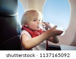charming kid traveling by an... | Shutterstock . vector #1137165092