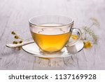 green tea in a cup on a white... | Shutterstock . vector #1137169928