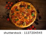 delicious pizza in an wooden... | Shutterstock . vector #1137204545
