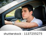 young handsome man driving his... | Shutterstock . vector #1137255275