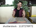 surprised young man holding a... | Shutterstock . vector #1137278972