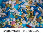 spilled colored medications and ... | Shutterstock . vector #1137322622