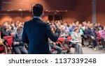 speaker giving a talk on... | Shutterstock . vector #1137339248