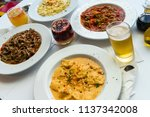 table with pasta dishes with... | Shutterstock . vector #1137342008