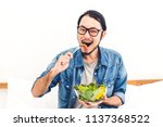 young man eating organic... | Shutterstock . vector #1137368522