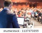 speaker giving a talk on... | Shutterstock . vector #1137373355