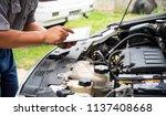 professional mechanic checking... | Shutterstock . vector #1137408668