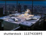 rooftop restaurant dinner table | Shutterstock . vector #1137433895