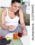 pregnant woman drinking tea with honey - stock photo