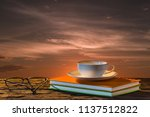 white cup of coffee on book and ... | Shutterstock . vector #1137512822