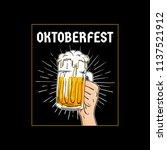oktoberfest hand holding full... | Shutterstock .eps vector #1137521912