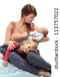 Young mother with her babies. - stock photo