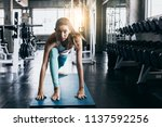 attractive woman exercise... | Shutterstock . vector #1137592256