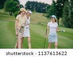 women in caps with golf...   Shutterstock . vector #1137613622