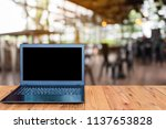 the notebook computer is on the ... | Shutterstock . vector #1137653828