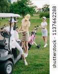 female golf players in caps at... | Shutterstock . vector #1137662288
