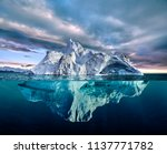 Iceberg With Above And...