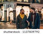 front view of two men walking... | Shutterstock . vector #1137839792