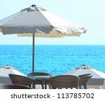 Sun umbrella at seaside - stock photo