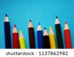 Small photo of Colored pencils placed over a blue background, giving a sense of colorfulness.