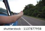 female arm outside of retro car ... | Shutterstock . vector #1137877958