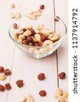 hazelnuts  cashews on white... | Shutterstock . vector #1137914792