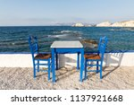 table and chairs standing on... | Shutterstock . vector #1137921668
