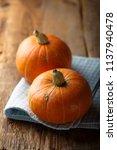 fresh pumpkin on desk | Shutterstock . vector #1137940478