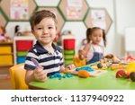 preschool children and teacher... | Shutterstock . vector #1137940922