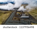 Hellisheidi geothermal powerplant shot from the air in early june, pipes an stam visible