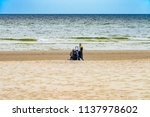the old man sitting on the... | Shutterstock . vector #1137978602