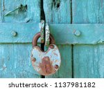 old rusty padlock on the green... | Shutterstock . vector #1137981182