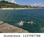 children jumping into the sea... | Shutterstock . vector #1137987788