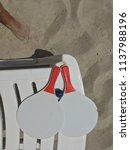 racket beach ball in sand | Shutterstock . vector #1137988196