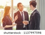 two businessman shaking hands... | Shutterstock . vector #1137997598