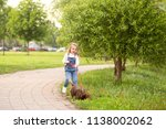 a little girl  a blonde  walks... | Shutterstock . vector #1138002062