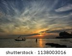 a fisherman is coming home... | Shutterstock . vector #1138003016